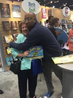 Kwame Alexander hug